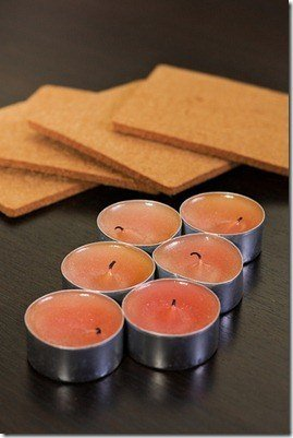 Aromatherapy candles next to brown coasters