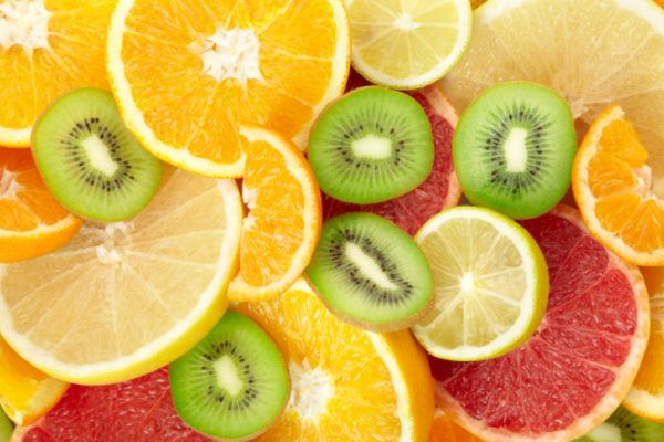Citrus fruit and kiwi background