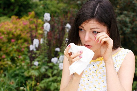 woman sneezing from hayfever